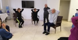 Exercise using chairs